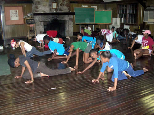 Campers practice yoga, led by Sita and Nykeia