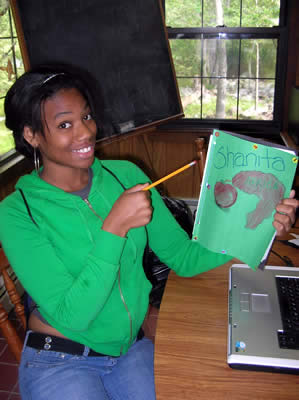 Shanita, one of our junior counselors, helping out with creative writing class