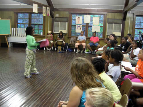 Nubea reads her poetry at Camp Sojourner Talent Show